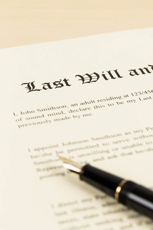 decease: Last will on cream color paper and pen concept for legal document