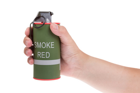 Red smoke grenade in hand isolated on white Stock Photo