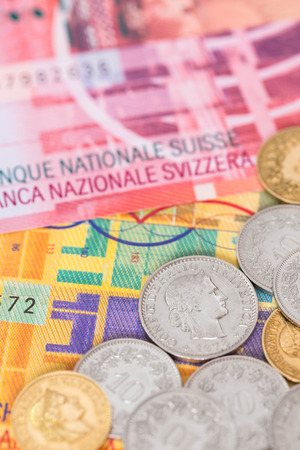 Switzerland money swiss franc banknote and coins close-up (focus on coin) photo