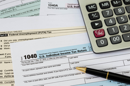 Tax form with pen, and calculator taxation concept Stock Photo