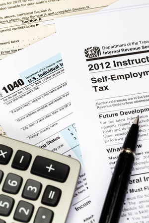 financial official: Tax form and instruction with pen, and calculator taxation concept Stock Photo