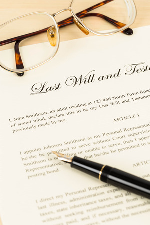 legal document: Last will on cream color paper with glasses and pen concept for legal document Stock Photo