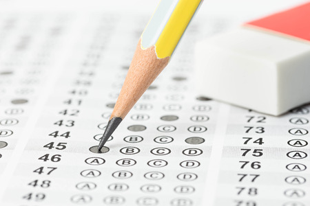 Filled answer sheet with eraser focus on pencil photo