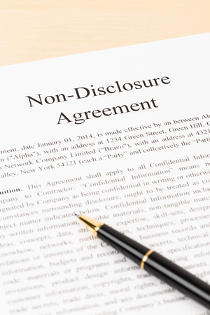 disclosure: Non disclosure agreement document with pen