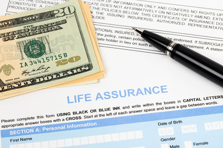 Life assurance application form with banknote and pen concept for life planning photo