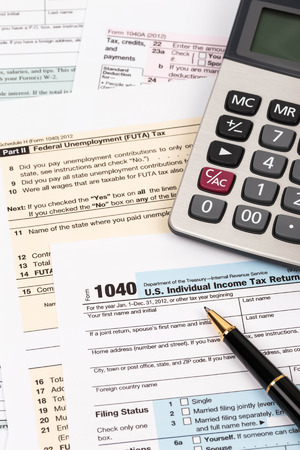Tax form with pen and calculator taxation concept Standard-Bild