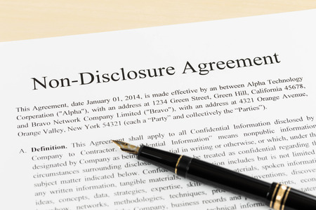 non: Non disclosure agreement document with pen close-up
