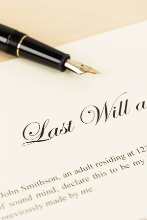 Last will on cream color paper and pen concept for legal document photo