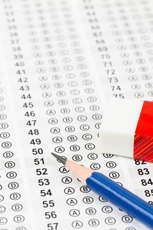 Blanked answer sheet with eraser focus on pencil photo