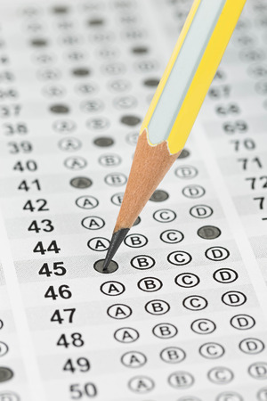 Filled answer sheet focus on pencil photo