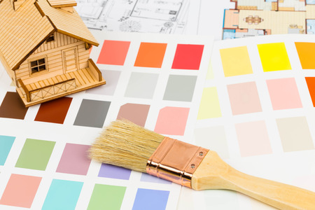 Paint color sample catalog with brush, drawing, and house model