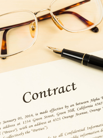 financial official: Business contract document on cream color paper with pen and glasses
