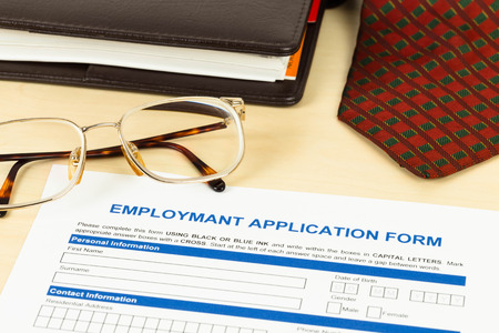 Application form, neck tie, glasses, and planner photo
