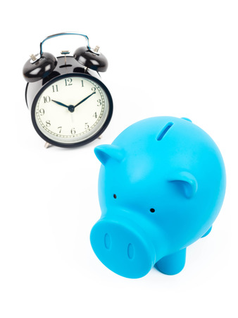 Piggy bank and alarm clock concept for saving time