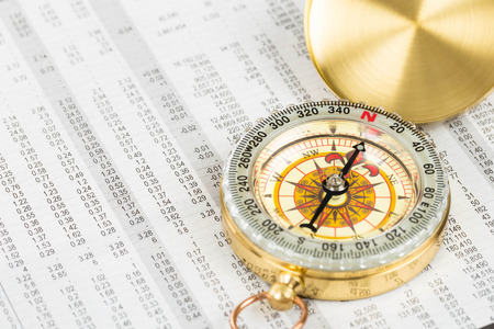 stock price: Compass on stock price report investment concept