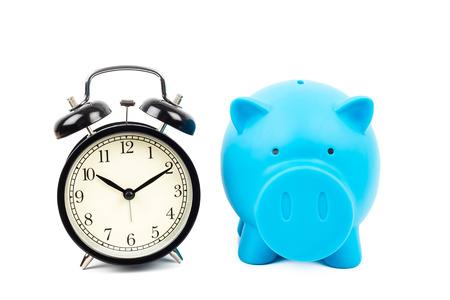 Alarm clock and piggy bank concept for saving time Stock Photo