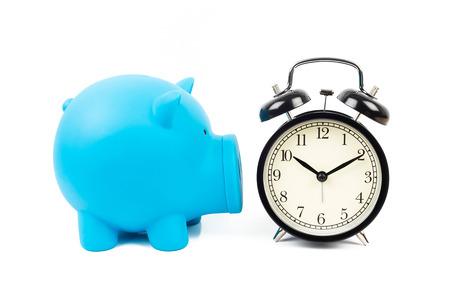 Alarm clock and piggy bank concept for saving time photo