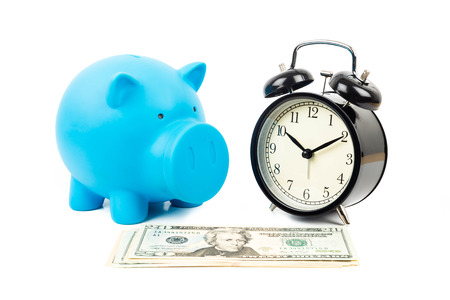 Alarm clock, piggy bank, and dollar banknote concept for saving time photo