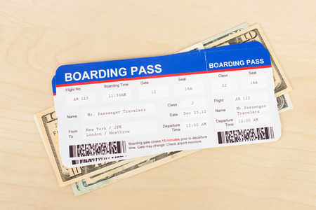 Boarding pass and dollar banknote concept for travel expenses Stock Photo