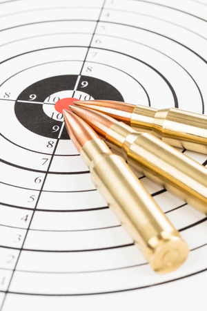 m16 ammo: Rifle bullet over target background