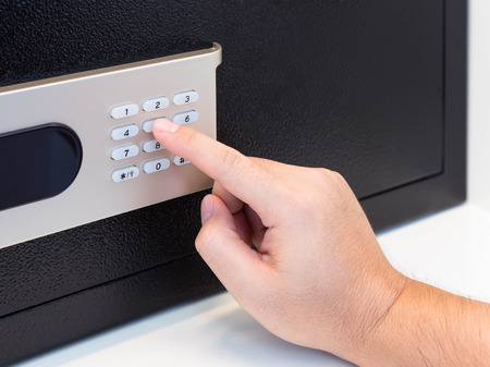 pin entry: Pressing code on a safe box