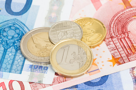 Euro money banknote and coins close-up photo