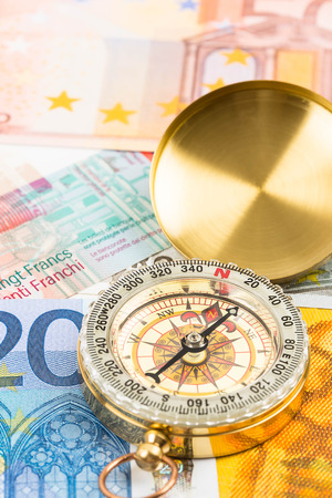 guideline: Compass on european banknote concept financial direction Stock Photo