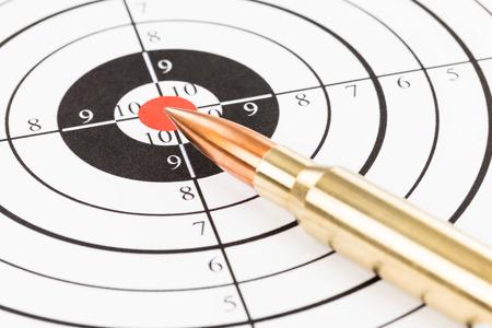 Rifle bullet over target background