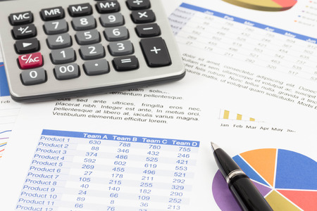 brand monitoring: Sales report analysis with pen, and calculator