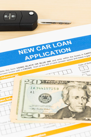 car loan: Car loan application with car key and dollar banknote Stock Photo