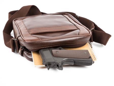 Brown messenger bag with gun hidden