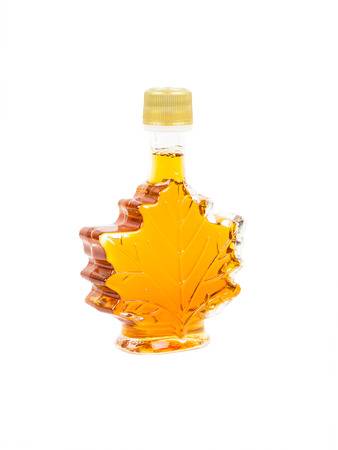 maple syrup: Leaf shape maple syrup bottle on white background Stock Photo