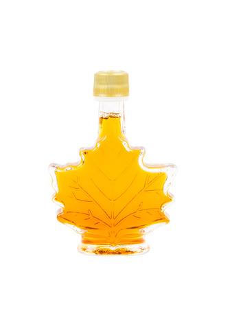 Leaf shape maple syrup bottle on white background Stock Photo
