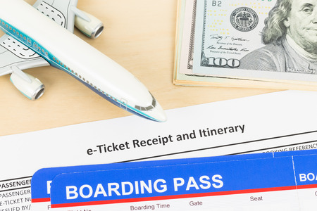 e ticket: E-ticket with plane model, banknote, and boarding pass