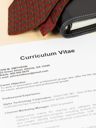 Curriculum vitae or CV with organizer and neck tie; concept job applying Stock Photo