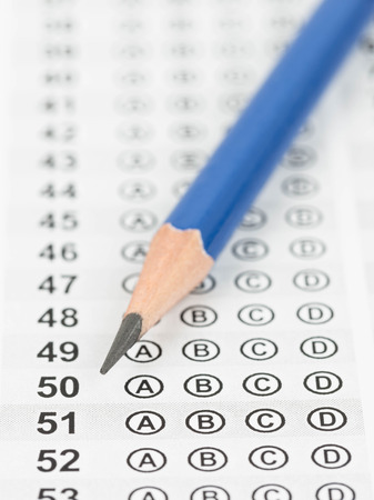 Blanked answer sheet with pencil close-up photo