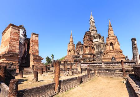 maha: Standing Buddha statue in Wat Maha That, Shukhothai Historical Park, Thailand