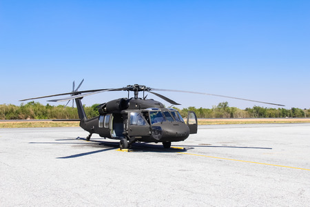 helicopter pilot: Military helicopter blackhawk at a base