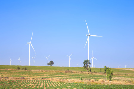 power generator: Wind turbine power generator in green field Stock Photo