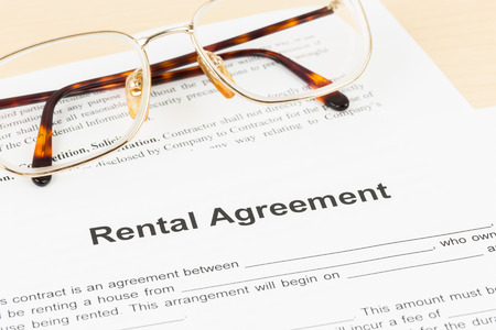 rental: Rental agreement document with glasses