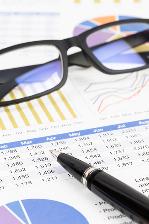 brand monitoring: Sales report analysis with pen, and glasses Stock Photo