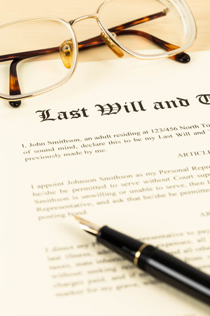 Last will on cream color paper with glasses and pen concept for legal document Stock Photo