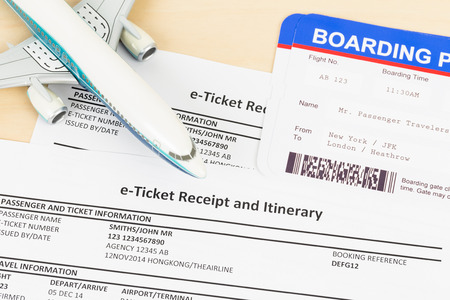 e ticket: E-ticket with plane model, and boarding pass