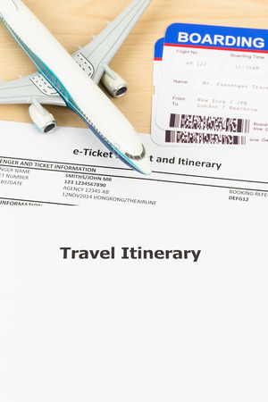 e work: Travel itinerary with copy space, plane model, and boarding pass