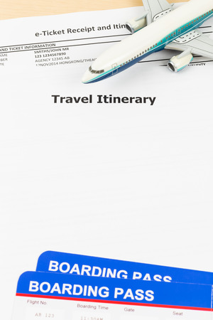 itinerary: Travel itinerary with copy space, plane model, and boarding pass