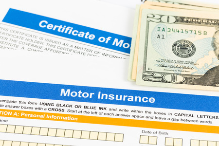 Motor or car insurance application with dollar banknote