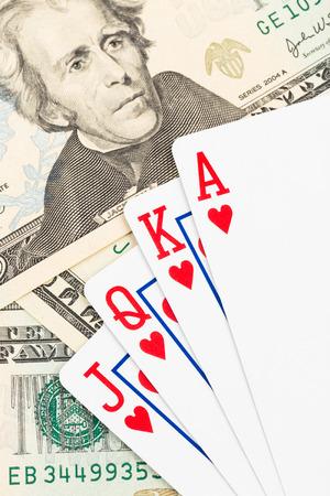 flush: Royal flush poker playing cards on dollar banknote