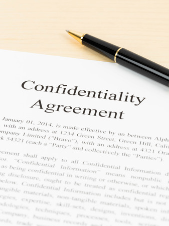 confidentiality: Confidentiality agreement document with pen close-up