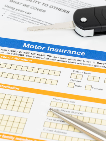 Motor or car insurance application with pen and car key photo