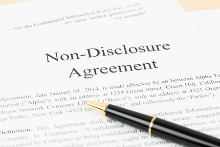 non: Non disclosure agreement document with pen